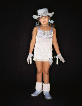 Child Beauty Pageant Contestant Wearing Cowboy Hat, Gloves And Pigtails