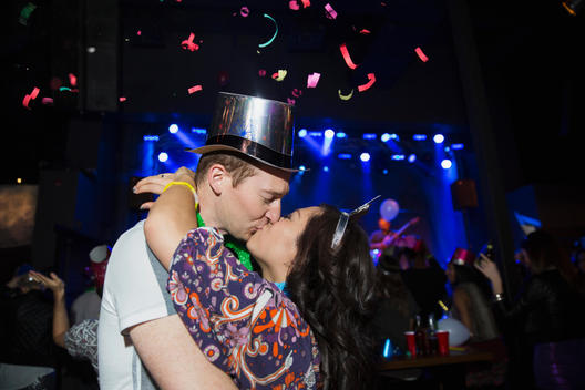 Couple kissing at New Year celebration