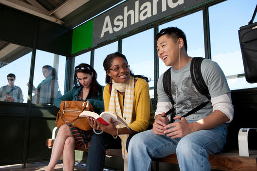 Young People Wait For A Train On A Chicago L Platform.