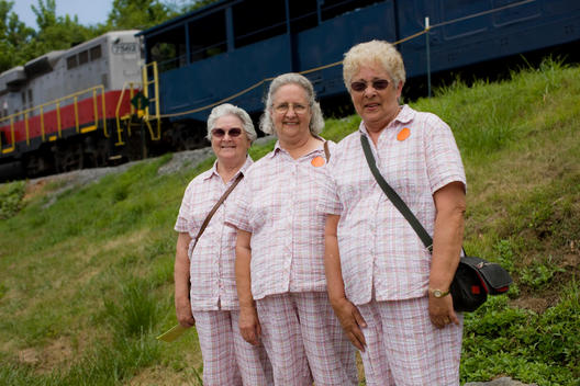 Senior Sisters Dressed In Matching Outfits Pose For A Photograph In Front Of The Blue Ridge Scenic Railway, Mccaysville, Georgia