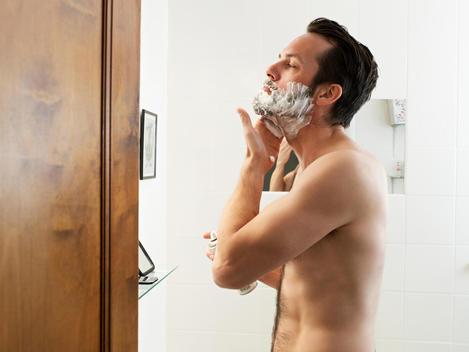 Mature Man Applying Shaving Foam In Bathroom