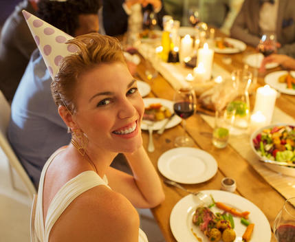 Woman smiling at birthday party