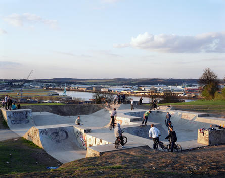 Teenage Bmx Riders And Skateboarders At A Skate Park During Sunset, Chatham, Kent, England, United Kingdom.