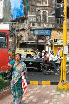 public bus, motorbike, taxi and woman wearing sari in the streets of Bombay
