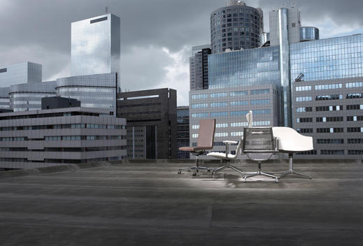 Luxury Office Chairs With A Skyline Of Silver Colored Modern Office Buildings In The Background