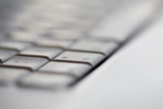 Extreme close up of a laptop computer keyboard