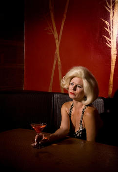 Sad, Lonely Woman Drinks Martini At Bar
