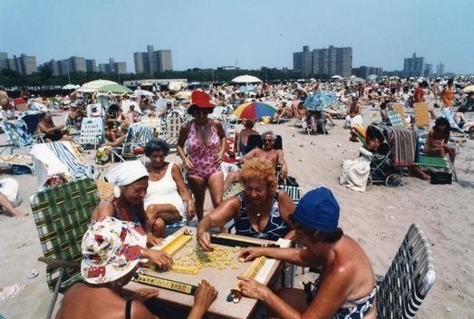 Mature / senior women play a game at the beach