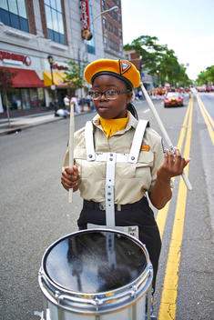 girl with drums at the memorial day parade