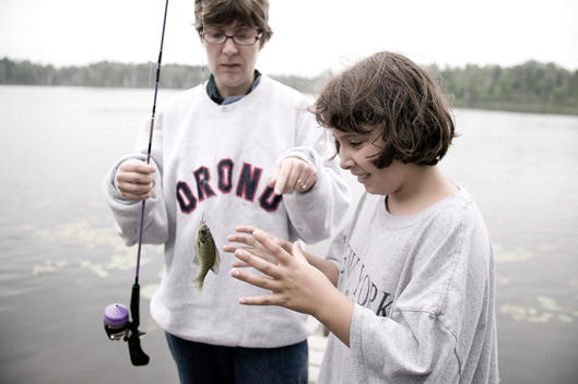 Mother And Daughter Fishing Together, Blue Lake, Minnesota, Usa.