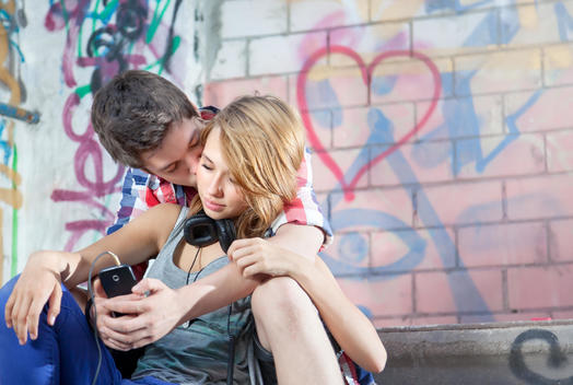 Germany, Berlin, Teenage couple falling in love