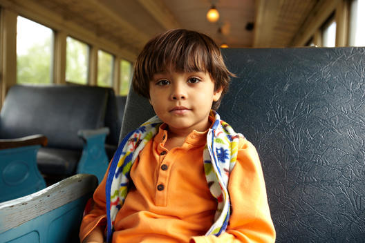Mixed race boy riding on train
