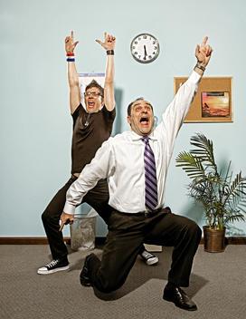 Two men celebrating by yelling Hoo Yaa