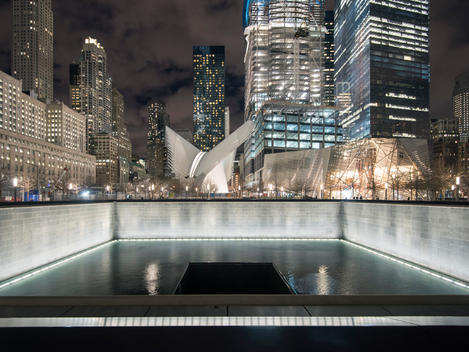 The Memorial Fountain and the Transportation Hub in illuminated in the background. World Trade Center