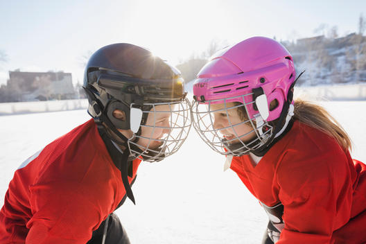Ice hockey players facing off on rink