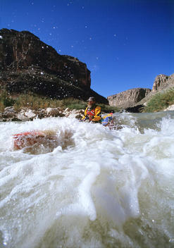 White water canoeist running Rodeo Rapid, Rio Grande