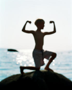 Silhouette Of Child Flexing