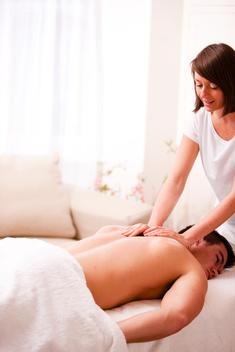 Masseuse giving a man a massage