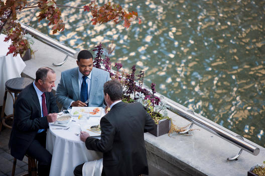 A Business Lunch At An Outdoor Patio Next To The Chicago River.