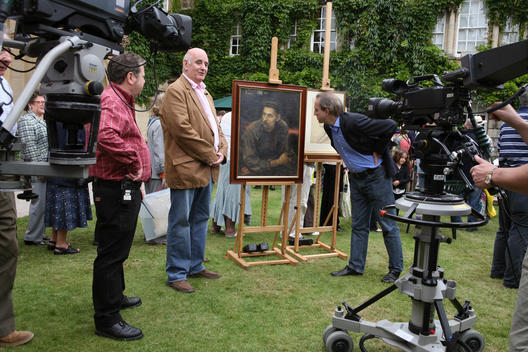 The BBC television program Antiques Roadshow filmed its 31st series at Hertford College, Oxford. Here Antiques expert Philip Mould (wearing blue pin striped jacket) inspects an original sketch by the Russian artist Ilya Repin (dated 1917) which he valued