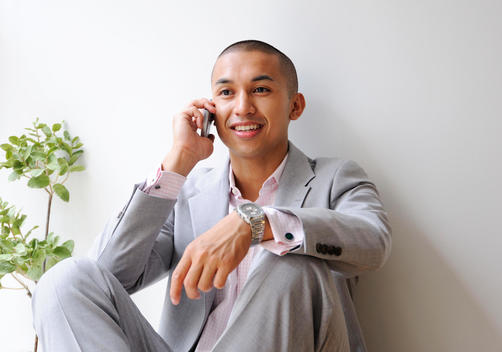 Young Business Man Talks On His Cell Phone.