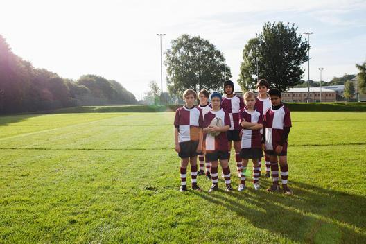 Group portrait of teenage schoolboy rugby team