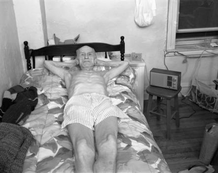 Portrait Of Senior Man Relaxing On Bed.