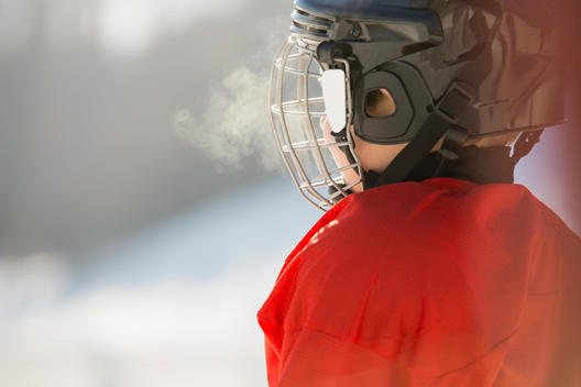 Side view of boy in ice hockey helmet