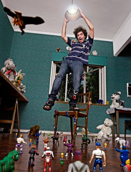 Mature Man Escaping Attacking Toys