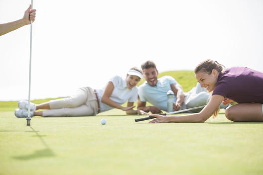 Friends laying on golf course