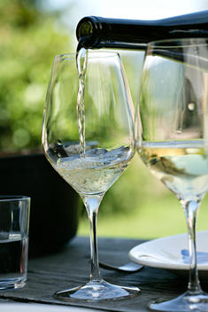 White wine being poured into wine glasses