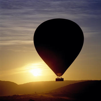 People Sightseeing At Dawn In A Hot Air Balloon, Masai Mara Game Reserve, Western Kenya, Kenya.