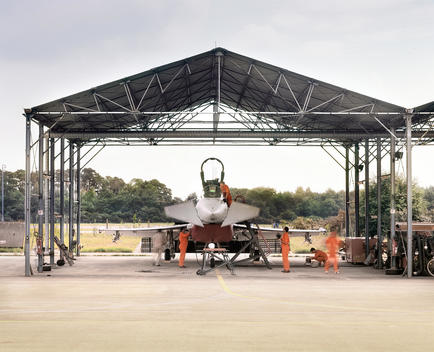 Eurofighter In Shed With Mechanics Working On It, Munich, Germany.