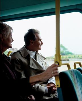 Senior Couple Riding Bus