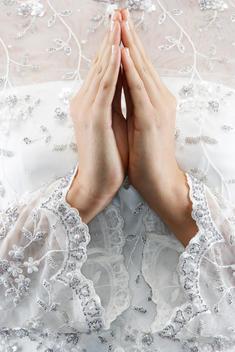 Mixed race bride\'s hands in prayer position