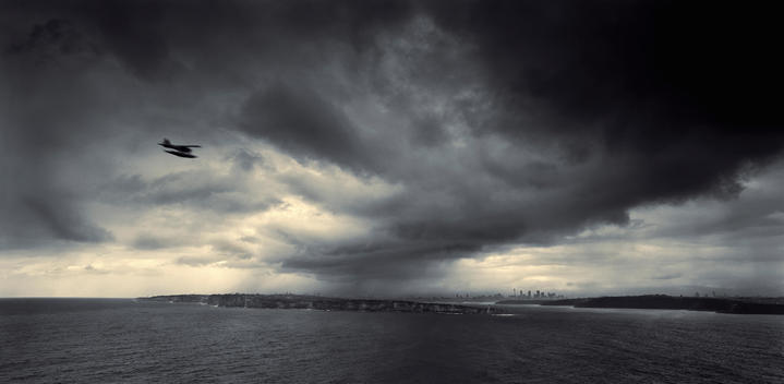 Sea Plane Flying Into Storm Over Harbor