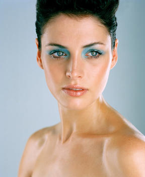 bright blue eye shadow on beauty model