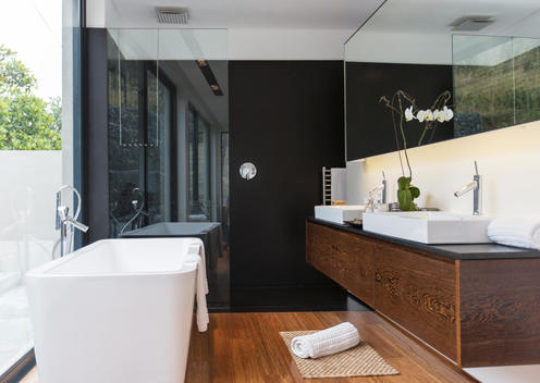 Bathtub and sinks in modern bathroom