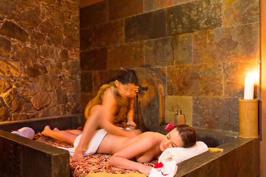 Female Massage Therapist Giving Woman a Back Massage