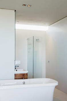 Bathtub, shower and sink in modern bathroom