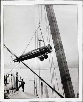Loading An Airplane Onto A Ship.