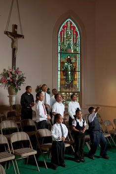 Group Of Children Of African-American Appearance Catholic Church Smiling And Having Fun During Choir Practice