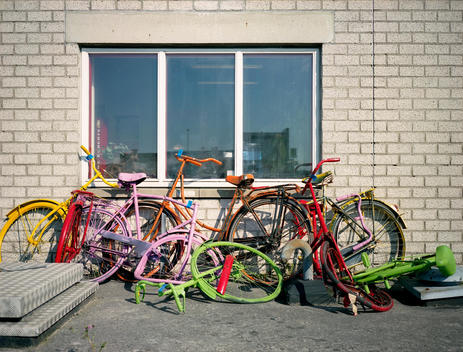 Bicycles Leaned Up Against Wall