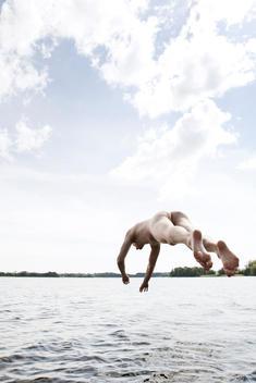 Nude Man Jumping Into Lake