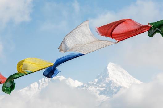 Prayer flags hanging in front of Annapurna South peak, Ghorepani, Annapurna District, Nepal
