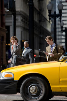 Business People Cross A Busy Chicago Street.
