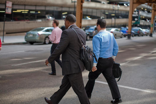 Men In Business Attire Walk Across A Chicago Street.