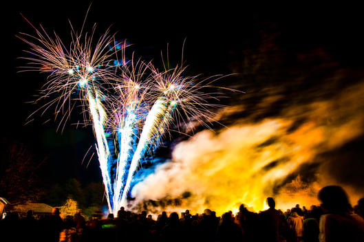 A Crowd Watch A Firework Display On Guy Fawkes Night.
