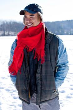Portrait Of Outdoorsy Man In Snowy Field