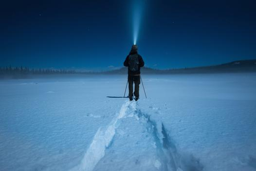 Man cross country skiing in moonlight, Carmi Cross Country Ski Loop, Penticton, British Columbia, Canada